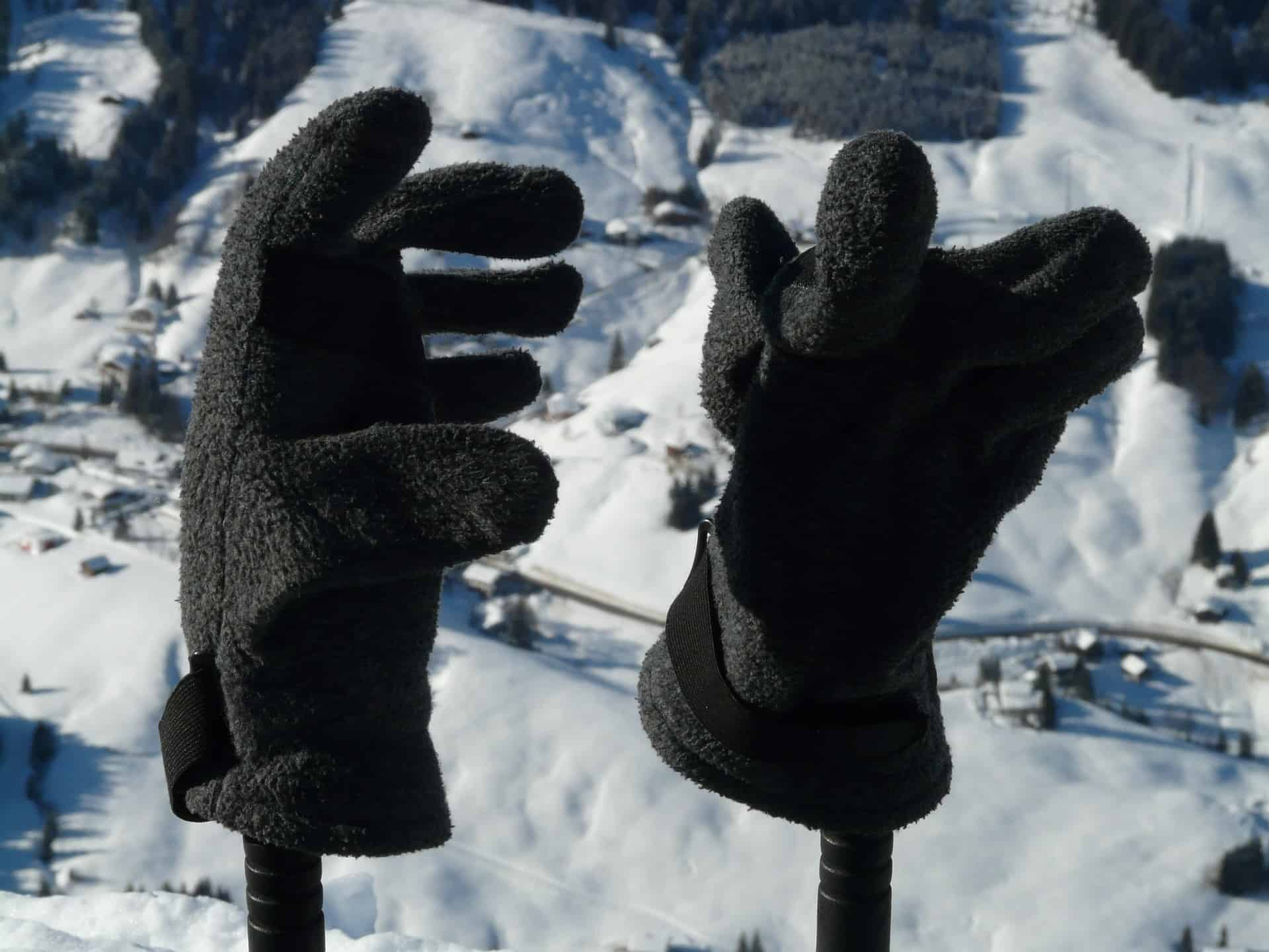 Ski gloves on pole