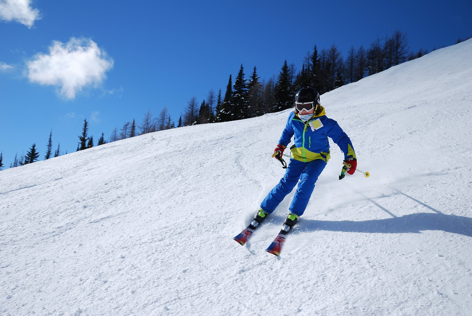 Downhill skiing in blue outfit