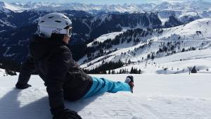 Skier sitting and relaxing on the slope
