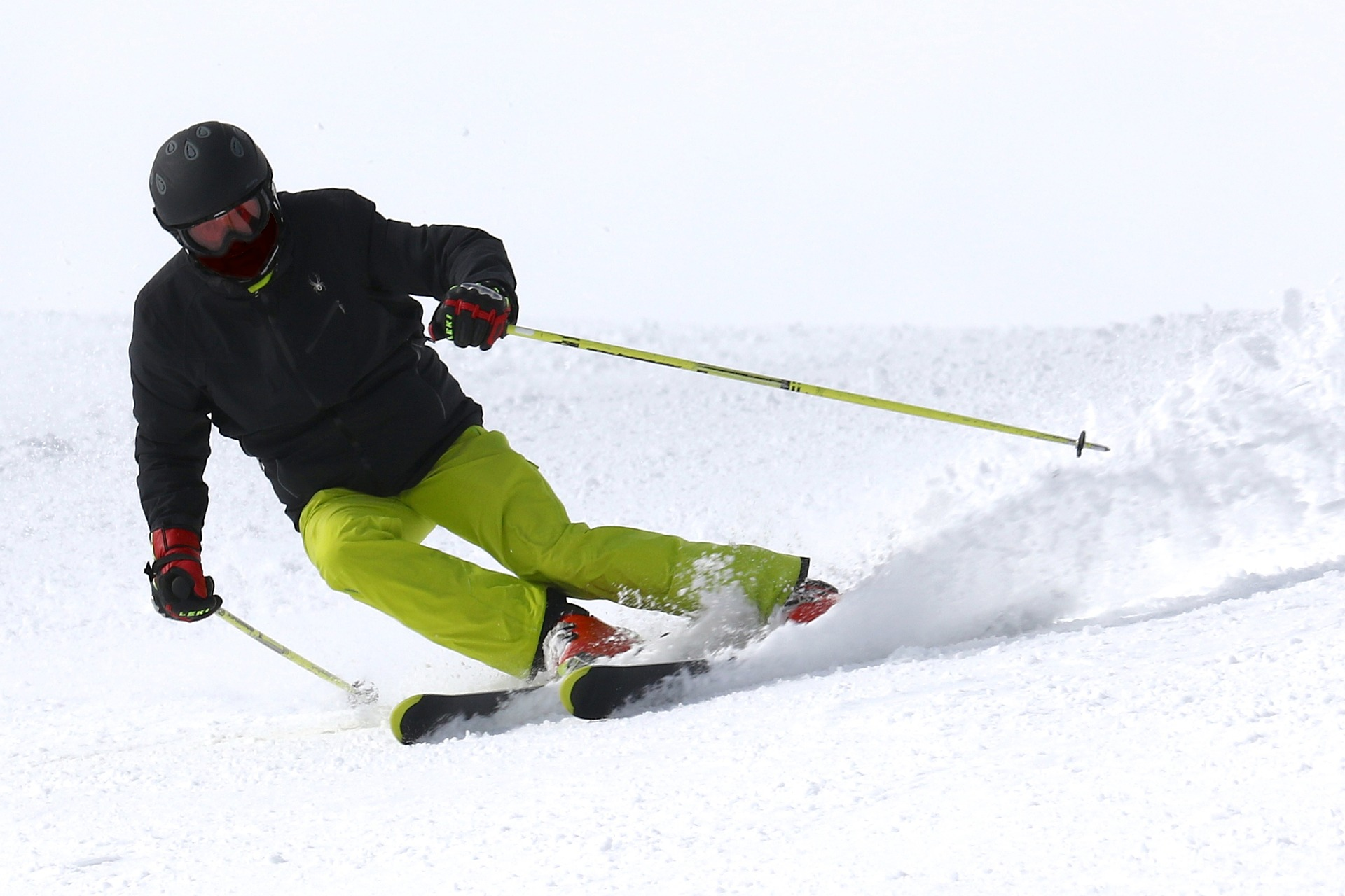 Man skiing in black and yellow